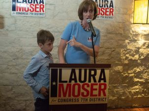 Still, She Persisted: Texas Congressional candidate Laura Moser with her son Leo at a campaign event.