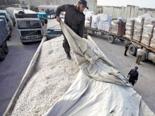 Building in Gaza: A Hamas official checks a truck loaded with gravel at the Kerem Shalom crossing. The delivery is the first allowed in six years.
