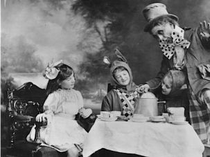 Go Ask Alice: The Mad Hatter's tea party as seen in a 1910 theater production of 'Alice In Wonderland.'