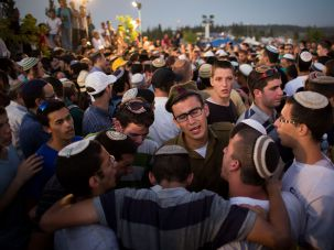 Crowds gather to mourn at funeral of Eyal Yifrah, 19, Gilad Shaar, 16, and Naftali Fraenkel, 16.