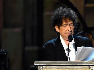 Not a Traditionalist: At one time, Dylan (seen here speaking at a recent MusiCares event) was generally disdainful of the Tin Pan Alley model.