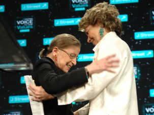 Surprise: Supreme Court Justice Ruth Bader Ginsburg (left) made an unexpected visit to the con- ference to help honor Kathleen Peratis (right), who received J Street?s Tzedek V?Shalom award.