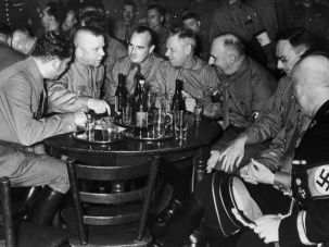 Legacy of Evil: Hans Frank (third from left) with other Nazi officials at a celebration for the 15th anniversary of the Beer Hall Putsch in Munich, 1938.