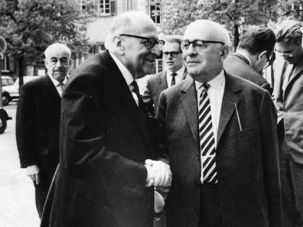 Frankfurt Seems Like a Long Time Ago: Adorno (left) and Horkheimer (right), with Habermas in the background (hand in his hair) at the German Sociology Conference, focused on Max Weber, at Heidelberg in 1965.
