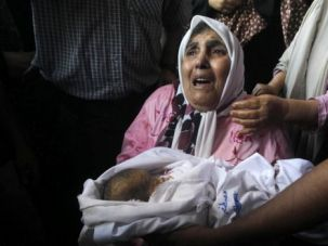 Life and Death: Surviving members of the al-Ghoul family mourn a 24-day-old baby who was killed in an Israel strike, along with nine other family members.