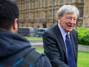 Lord Alf Dubs speaks to two child refugees from Syria on April 25, 2016 in London, England.