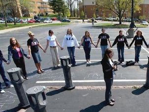 Sisters: Members of the Alpha Xi Delta sorority hold a vigil in 2004 at the spot where Sandra Scheuer, a fellow sorority member, was killed on the Kent State University campus. The campus deaths are commemorated yearly.