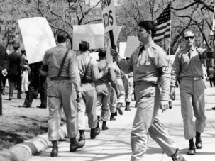 50 Years Ago: American neo-Nazis march against Communism while police officers guard against violence.
