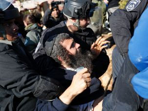 Amona settlers during the evacuation by Israeli police.