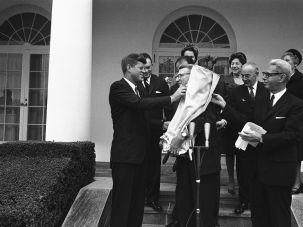 Thanks Jack: Members of the Religious Action Center present President John F. Kennedy with a Torah scroll to mark the founding of the group in 1961.