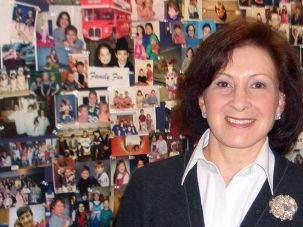 They Are Family: Dr. Felicia Axelrod has pioneered life-saving treatments for those afflicted with familial dysautonomia, such as the patients featured on the wall of photos behind her.
