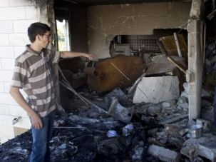 Family members examine the wrecked home of alleged kidnap ringleader Marwan Qawasmeh after Israeli troops demolished it in retaliation for the terrorist murder.