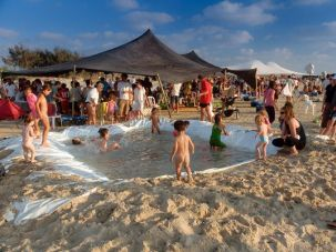 All Together Now: A pool built on the beach draws a crowd as the Maagan Michael kibbutz celebrated 60 years.