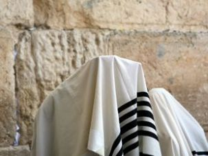 Priestly Blessing: An Orthodox man performs the Birkat Kohanim at the Western Wall.