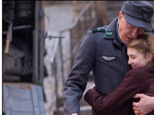 Thieves of Hearts: Liesel (Sophie Nélisse) and her foster father Hans (Geoffrey Rush) embrace in the film adaptation of ?The Book Thief.?