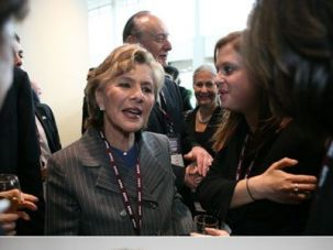 A Diverse Jewish Vote: Senator Barbara Boxer (top) meets with attendees at a recent California event sponsored by AIPAC, the pro-Israel lobby. GOP challenger Carly Fiorina (second from left, bottom) poses with members of Thirty Years After, an Iranian-Jewish group.