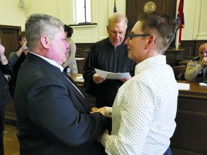 No Time Like Now: Chris Whitaker (left) and Elaine Brune got married in a civil ceremony in St. Louis in early December rather than wait for a year-and-a-half, as they had planned.