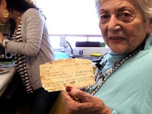 Ruth Levy holding her chrimslech recipe card
