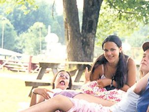 Summertime: Gabe Zimmerman (right) with Kinderland campers in the summer of 2001. Maia Falconi-Sachs (second from left) remembers thinking he was the ?coolest person in the world.?