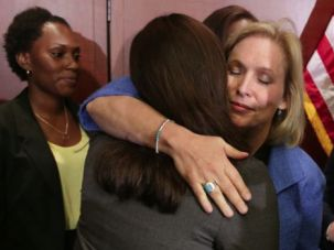 Looking for Justice: Senator Kristen Gillibrand embraces End Rape on Campus co-founder Andrea Pino, a survivor of sexual assault at the University of North Carolina, during a news conference in July about new legislation aimed at curbing sexual assaults on college campuses.