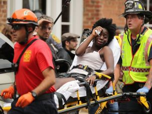 Rescue workers move victims on stretchers after a car plowed through a crowd of counter-demonstrators against a white supremacist rally in Charlottesville, Virginia.
