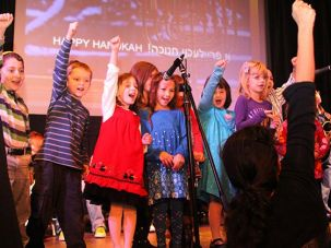 Young Yiddishists: Children perform at an annual Hanukkah celebration at a Long Island shule of the Workmen?s Circle.
