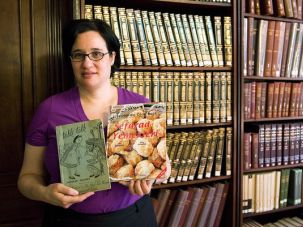 From the Kitchen: Roberta Saltzman shows off two of the 700 cookbooks she?s collected on her own and donated to The New York Public Library.