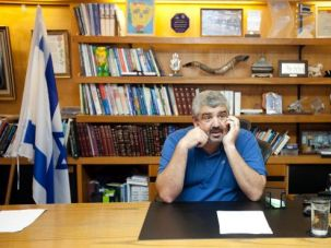 Bay Yam Mayor Shlomo Lahiani has been charged with corruption, but he says public will judge him at the ballot box.