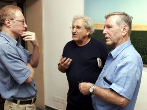 Grossman, left, speaks with the novelists A.B. Yehoshua, center, and Amos Oz, left, in 2006.