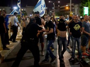 'Burn the Leftists!': A mob of extreme-right activists attack a peaceful demonstration in Tel Aviv on June 12.