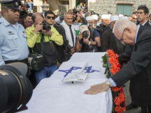 An Israeli-Druze: Israeli President Reuven Rivlin pays his respects on the coffin of Israeli police officer Zidan Saief, 30, a member of Israel's Druze minority, who died in an attack on a Jerusalem synagogue on November 18.