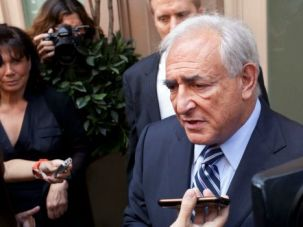 Dominique Strauss-Kahn being questioned by reporters in New York in 2011.