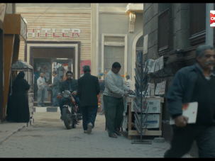"A screenshot from the Egyptian TV series ""Alzyb'a,"" showing a shop named after Adolf Hitler."