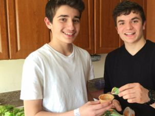 Brothers Gabriel (right) and Raphael Shpitalnik make their kosher Angel Rolls after school twice a week.