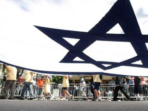 What Israel Means: Marchers in New York City?s 2009 Salute to Israel Parade carry a giant Israeli flag.