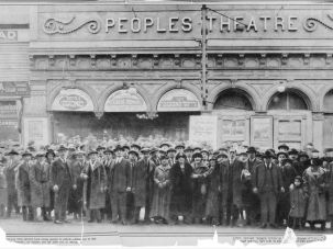 "A mass of theatregoers outside the Peoples Theatre, waiting for tickets to the Yiddish play ""The Great Moment,"" which ran 1927-28. Many were turned away, the tickets having sold out well in advance."