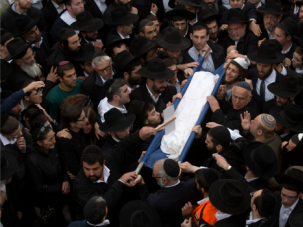 Hundreds gather in Israel to bury the seven children killed in a deadly Brooklyn blaze.