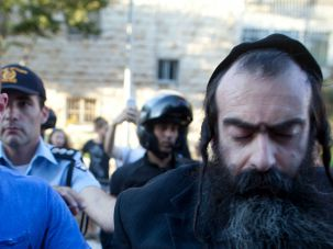 Suspected anti-gay attacker is arrested after several people were stabbed at Jerusalem gay pride parade.