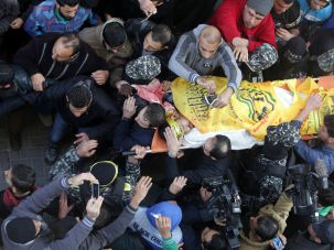 Palestinian mourners carry the body of Mussa Abu Zuaiter, a Palestinian man who was killed in an Israeli air strike on the Gaza Strip, during his funeral in the Jabalia refugee camp in the northern Gaza Strip on January 13, 2016. An Israeli air raid in the northern Gaza Strip targeting alleged militants killed one Palestinian and wounded three others, the Israeli army and a Palestinian official said. / AFP / MAHMUD HAMS (Photo credit should read MAHMUD HAMS/AFP/Getty Images)