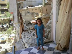 Falling Apart: Reem Abu Emer in her destroyed house in the village of Shejaiya.