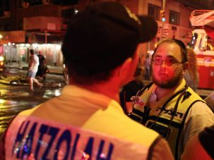 A Hatzolah ambulance crew responds to a fire in a synagogue on the Upper East Side of New York City in July.