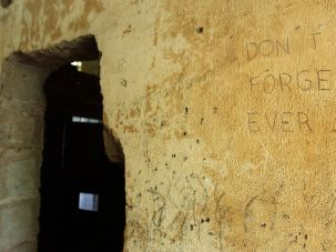 Graffiti marks the wall inside one of the buildings at the former Toul Sleng Prison in Phnom Penh, Cambodia.