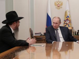 Russian president Vladimir Putin speaks with chief rabbi of Russia Berl Lazar in 2012.