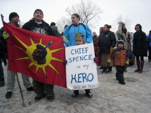 A young native girl and a native elder gather on Victoria island for a march on Canada's parliament in support of Attawapiskat Chief Theresa Spence's strike on January 11, 2013.