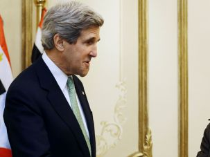 John Kerry (L) shakes hands with Abdel Fattah al-Sissi, during a meeting at the defense ministry in Cairo on March 3, 2013.