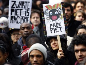 """A protest against """"Zwarte Piet"""", a blackface Christmastime tradition in the Netherlands."""