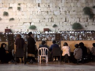 Women praying behind partition at the Western Wall.