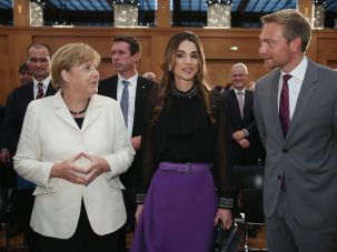 Prized: Christian Lindner pictured with Queen Rania of Jordan and premier Angela Merkel at an award ceremony in September 2015.