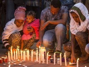 Members of the Eritrean community light candles in Tel Aviv to commemorate the killing of Habtom Zarhum.