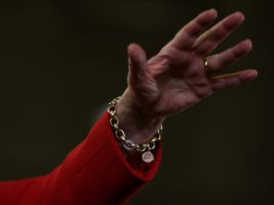Hillary Clinton wears a charm bracelet with an image of her granddaughter Charlotte Clinton Mezvinsky.